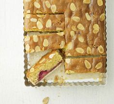Raspberry Bakewell slice - Get ahead this weekend and make this indulgent, freezable treat, perfect for pud or with a cup of tea Bbc Good Food Recipes, Sweet Recipes, Baking Recipes, Cake Recipes, Loaf Recipes, Freezer Recipes, Freezer Cooking, Party Recipes, Brownie Recipes