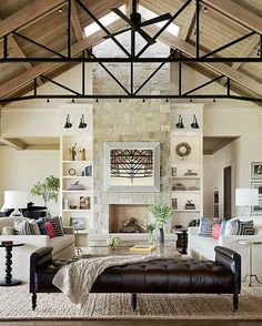 Can't get over the ceiling and the seriously styled shelves of this Napa style great room ❤️ Bonus: the mirror lifts to reveal a TV. What a #designwins detail! Design by @jenniferrobininteriors #kathykuohome #interiordesign #beautiful #inspiration #homedecor #livingroom