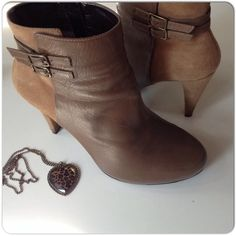 """EUC TAN SUEDE & LEATHER ANKLE BOOTS A mix of leather & suede in tan gives these boots lots of style. Side DKNY zipper, round toe, approximate 4"""" heel & double skinny belted embellishments. These are DKNYC & very little wear to the soles or lifts or the leather & suede. There are a couple of dark marks close to the bottom of the heels but these are in excellent condition! Size 7.5. DKNYC Shoes Heeled Boots"""
