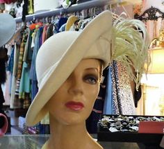 1960's Jack McConnell -- vintage ivory cream   formed side tilt hat with wide spray of thin feathers and rhinestone band