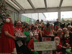 Staff at Asda Bodmin with a cheque for £1000!
