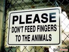 Really people? Do we really have to warn people not to feed their fingers to animals?