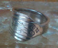 I made this silver spoon ring that had been bent into a not so attractive pendant