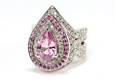 Pink sapphire with diamonds double halo engagement ring and matching contoured wedding bands.