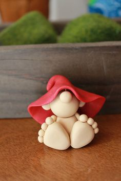Welcome to Gnome Woods!    This listing is for one (1) hand sculpted polymer clay baby gnome. He sits approximately 1.25 inches tall.