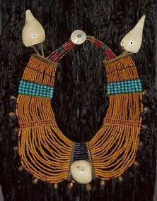 Naga,  Ceremonial Necklace,  Phom Tribe, Fine Collar Necklace, Rare Mustard Color Glass Beads, Spaced With Red Whiteharts, Sections Of Turquoise Padre Glass Beads, And A Center Of Blue Cobalt Glass. Each Section Is Bordered By Horn Separators With Ridged Brass Bells On Perimeter, Conch Shell Disc At Center. Conch Shell Sections As Weights At(Shell) Clasp. MUSEUM QUALITY