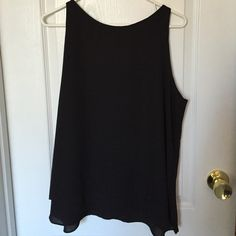Flirty Black Tank size L Fun chiffon black tank/shell size L. New without tags - never worn! Front has an overlay detail and the back has a batwing detail - see photos. Great from going from work to drinks! Audrey & Celine Tops Tank Tops