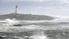 Waves crash along the shoreline at Peggys Cove Lighthouse after Hurricane Bill visited the province in 2009. The provincial government is considering taking over the lighthouse's upkeep.