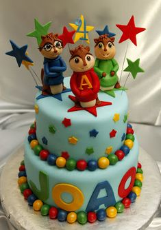 The chipmunks and all the decorations are made of fondant. French Vanilla Silk cake with strawberry filling and Milk Chocolate Fudge cake w...