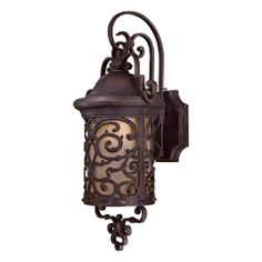 Outdoor sconce.....I would use this in conjunction with the pocket lantern.  This would be great for the build-outs surrounding the windows.  Maybe use the pocket lanterns on the back porch areas.....