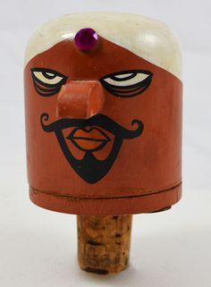 Wooden bottle stopper.