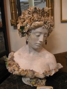 Shell encrusted bust
