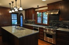 Dark Wood Cabinets in Traditional Kitchens