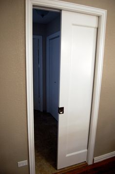Pocket Door Install - Makeover DIY project. Perfect for between the kitchen & utility room. This could really save room!