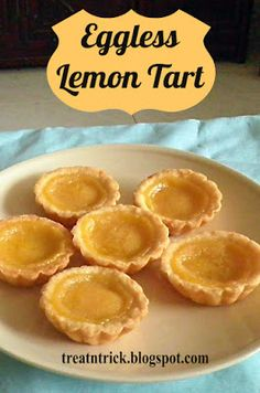 Eggless Lemon Tart Recipe @ http://treatntrick.blogspot.com This beautiful Lemon Tart was made with buttery crust and tangy sweet filling