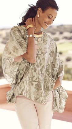 Fall in love with this romantic paisley poncho.