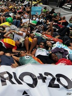 Negotiators have agreed a text to be approved by world leaders meeting this week in Rio to consider the worsening state of the global environment - Activists lie on Rio Branco in Rio de Janeiro  #RioPlus20