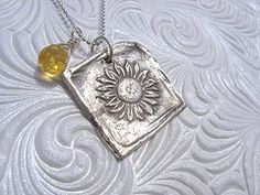 Shabby Chic Designs Hand Stamped Silver PMC Summer Days Sunflower Necklace. $54.00, via Etsy.