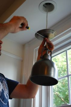 Replace over-sink recessed light with pendant. How-to photos included on blog.