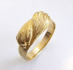 What a talented person! Paw to Paw Gold Ring  Animal Ring  Wolf Ring  by Ricksonjewellery, $875.00 on etsy