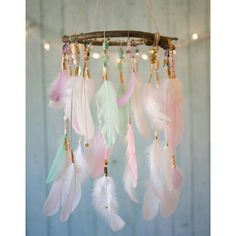 "Elegant Princess"" Dreamcatcher Mobile by @dreamkeepersllc Wow! This is so soft and subtle, with it's pastel color palette of white, cream, light green, light pink and lavender feathers. It features white, pink, lavender and cream string and some gold, silver and copper accents. It has a variety of shiny, sparkly beads in different shades to match. Dreamkeepersllc.etsy.com"