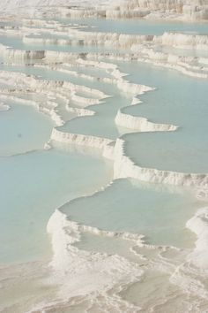 Pamukkale ('cotton castle' in Turkish) is a natural site in Denizli Province, Turkey, containing hot springs and travertines, terraces of carbonate minerals left by the flowing water. People have bathed in its pools for thousands of years. Places To Travel, Places To See, Travel Things, Beautiful World, Beautiful Places, Turkey Destinations, Travel Destinations, Nature Landscape, All Nature
