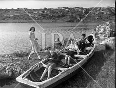 Gael Linn special at Carna. Boat Bulding with the Flaherty Kid playing in a boat. Cabin Cruiser, Rowing, Photo Archive, Picture Show, More Photos, Dublin, Kids Playing, Ireland, Irish