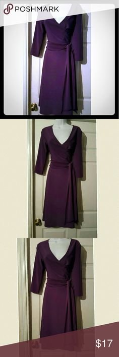 Beautiful plum jersey knit faux wrap dress Beautiful plum colored jersey knit faux wrap dress with deep v neckline and 3/4 length sleeves and a sash belt. Dress is in like new condition Dresses