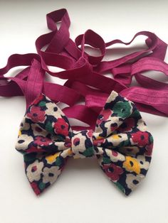 Navy Floral HeadBow on Wine Elastic by AvasAccessories1 on Etsy