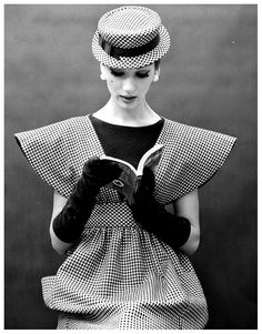 Simone DAillencourt in a broad-shouldered pinafore of checks worn over a black sheath by Traina-Norell, photo by Nina Leen, 1959