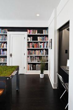Love the floor to ceiling bookshelf - black on white