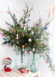Budget-Friendly Decorating Ideas for Your Most Stylish Christmas via Create your own Christmas tree in a bottle! Christmas Branches, Unique Christmas Trees, Alternative Christmas Tree, Noel Christmas, Christmas Wreaths, Beautiful Christmas, Simple Christmas, Tabletop Christmas Tree, Christmas Ideas