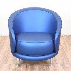 """A fun bucket chair was crafted by """"Moroso."""" This Mid Century Modern chair is upholstered in a futuristic electric blue vinyl fabric. The metal legs are in good shape. The fabric is in excellent condition. Definitely a statement piece for any home!   #midcenturymodern #chairs #chair #sandiegovintage #vintagefurniture"""