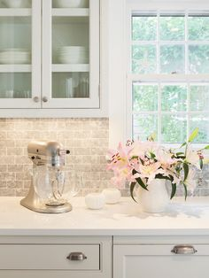 White kitchen cabinets, white quartz countertops, Bardiglio Marble Backsplash | Sophie Metz Design