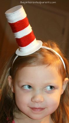 Toilet paper tube Dr. Seuss headband hat. Recycle cardboard rolls wrap with yarn for an easy Cat in the Hat inspired arts and craft project for the kids. A great fine motor activity as well.