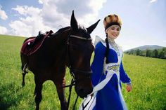 An Altai woman with her horse.