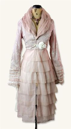 DUSTY MAUVE TEA JACKET — Ballet-chic. Dainty tiers of antique pink tulle and lace ruffles are flattered by hand-turned rosettes and embroidery. Tea length.