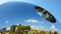 Reflections in the award winning stainless steel sculpture, the Torus