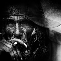This is a street portrait taken by a photography called Lee Jefferies who takes a lot of black and white photographs mainly of old homeless people. I really like this photograph because of how the man is smoking and looking straight into the camera because it makes me want to find more about the subject and what life he lives. I also really like the framing of this photo and how Jefferies has given no clues about the man in the photo.
