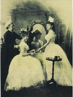 """Alix of Hesse prepares for her first ball in 1889. Arranging her hair is her English nurse, Mrs. Orchard, while her sister Yelizaveta Feodorovna (""""Ella"""") supervises."""
