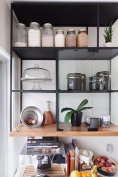 Glass shelves put all of your beautiful kitchen wares out on display. The storage of spices and flour in Mason jars is an especially charming touch.