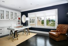Impressive Navy Blue Curtains trend Portland Contemporary Home Office Decorating ideas with black stained wood floor built-in cabinets chrome crown molding dark blue wall glass top