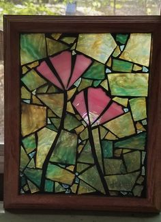 Stained glass mosaic flower panel by Chanda Froehle. More can be found at www www.facebook.com/groovysquidglass
