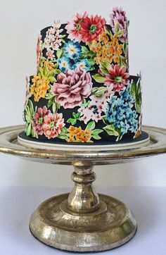 Eccentric hand painted flower wedding cake - cover the cake with black fondant, paint the flowers onto white gum paste and then cut them out. A labor of love!