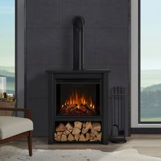 Real Flame Hollis Electric Fireplace Black - suited for many environments, the Hollis Electric Fireplace is designed to replicate the look of a built-in wood stove. A compact footprint allows practically endless placement options, even Indoor Electric Fireplace, Free Standing Electric Fireplace, Black Electric Fireplace, Indoor Fireplaces, Electric Wood Stove, Electric Fireplaces, Electric Log Fire, Indoor Wood Stove, Electric Log Burner