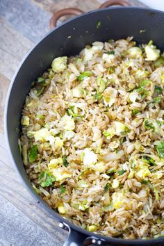 Thinly sliced Brussels Sprouts are paired with fried rice for the perfect healthy dinner! Super simple and ready in just 15 minutes!