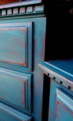 Turquoise, red glaze & distressed.
