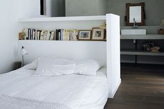 Headboard adds privacy and storage