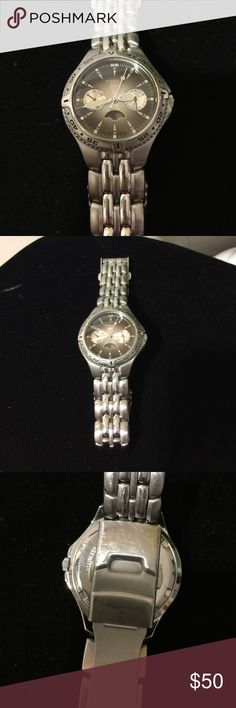 FOSSIL Men's 100 Meter Stainless Watch Pre owned no visible scratches on face or band. Except clasp photo 3 from normal wear. Working. Will replace with new battery before shipping. Stainless band, grey face. Fossil Accessories Watches