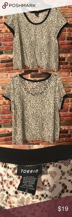 """Torrid Black & White Floral Lace Top sz 2 Torrid Black & White Floral Lace top. Torrid size 2 {2X}. No signs of wear, rips or stains. Has a fringe like bottom. Very cute with a tank underneath! Sleeves are 10"""". Length: measurement taken from shoulder seam to bottom of the top. Length: 26"""". From armpit to armpit: roughly 27"""" across. Check out my closet for more torrid. Bundle to save❤️ torrid Tops Blouses"""
